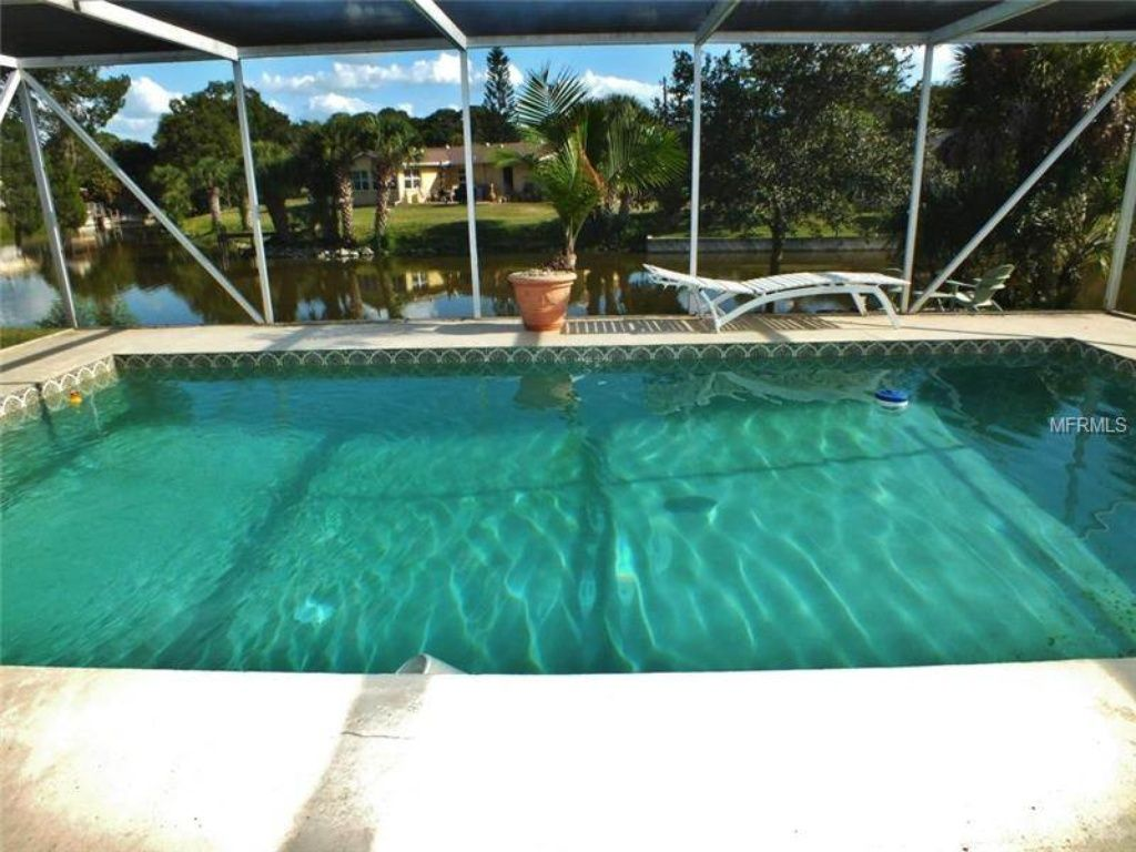 tropical lakefront  heated pool home less than 2 miles to