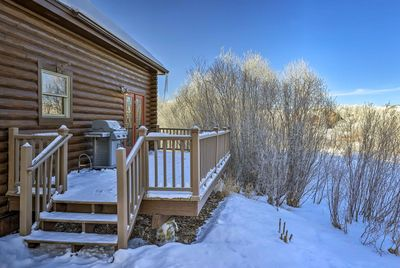 The traditional log home is situated about 30 minutes from Winter Park Resort.