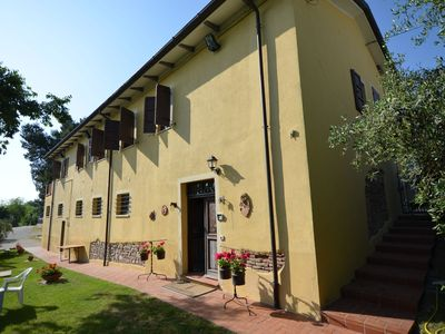 Photo for Apartment in the hills with swimming pool and view of vineyards and olive trees.