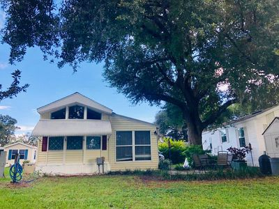 Photo for Cozy Lakeside Cottage 10 minutes From Disney World