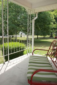 The front porch looking out. House sits on 1 acre, 6 miles to Downtown.
