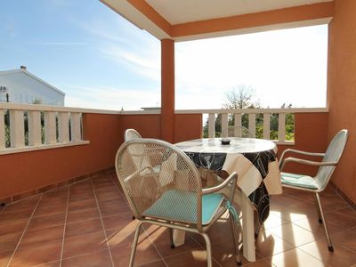 Photo for Two bedroom apartment with terrace and sea view Novalja, Pag (A-9336-c)