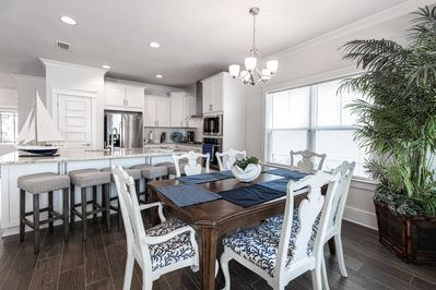 Kitchen & Dining Areas - When it's time to eat, the kitchen island seats 5, and a large wooden dining table seats 6.