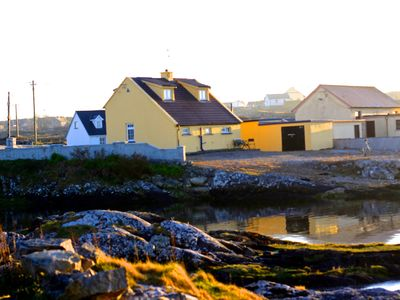 Photo for Connemara cottage right on the water - newly built room with spectacular views