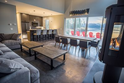 A large kitchen/living/dining area with fireplace makes a cozy hangout