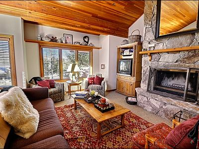 The Living Room Features Vaulted Ceilings and a Lovely Stone Fireplace