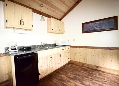 Kitchen area... includes small fridge, Microwave, and One burner hot plate.