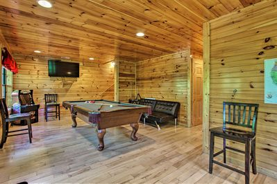 The cabin has everything you need, including a game room.