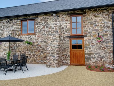Photo for Beautifully converted barn with Jacuzzi, just outside Exmoor National Park