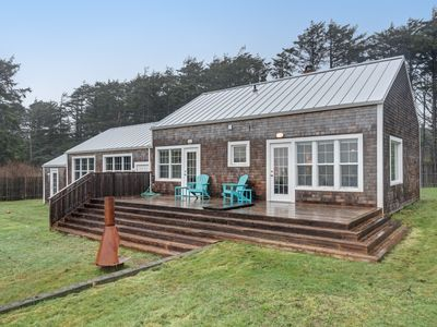 Photo for Stunning beachy cottage w/ ocean views, enclosed yard, & nearby beach access