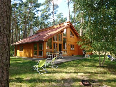 Photo for Stylish, light wood house by the woods in the immediate vicinity of clear lake