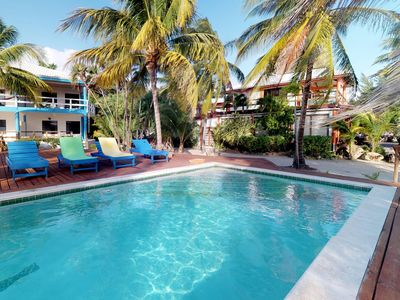 Photo for Romantic beachfront getaway with shared pool, ocean views, and topical style