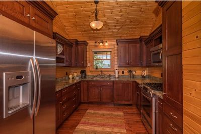 Updated cabinetry.....top of the line appliances....granite countertops