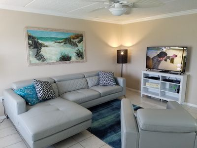 Photo for Spacious 3rd Floor Condo - Minutes from Beach or Bay - with shared Pool!