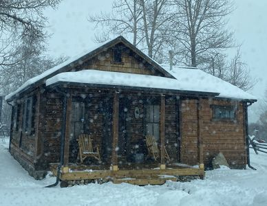 Photo for 1865 historic cabin with Hot Tub- close to red  lodge!