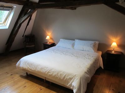Photo for Converted Barn - Exposed stone walls and beams, a beautiful building in