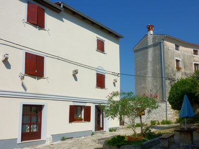 Photo for Stylishly restored stone house in the middle of the old town for up to 6 people