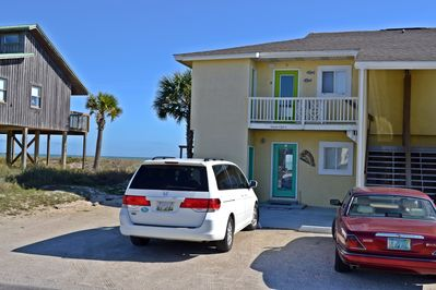 The unit is upstairs to the left.  The beach and Gulf are on the other side