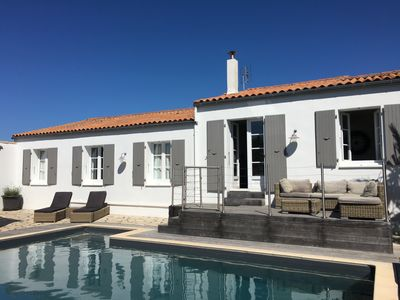Photo for 4 bed/2 bath house with heated pool in walled town of St Martin de Re