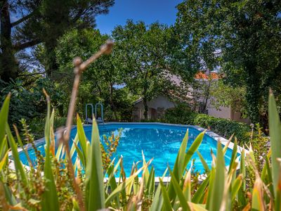 Photo for Kids friendly house with large fenced private garden, pool, playtower, beach 1km
