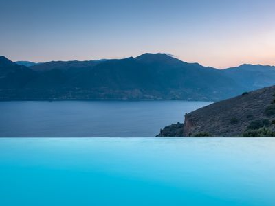 Photo for Luxury spacious quiet stone villa with  large infinity pool & breath taking view