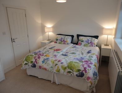 King Bed with individual duvets and bathroom en suite