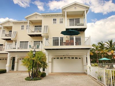 Photo for Stylish townhome w/ shared pool and spa right across the street from the beach