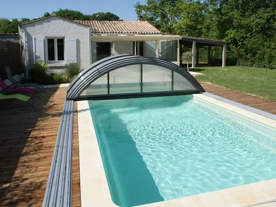 Photo for Villa wooded view private pool, heated and covered at Château d'Oléron