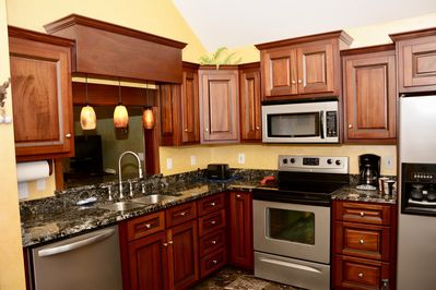 This gorgeous kitchen is fully equipped  with grill, toaster, coffee maker plus