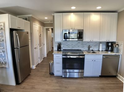 Newly renovated fully stocked kitchen. Full size stainless appliances & granite!