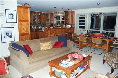 The open concept fully equipped kitchen, dining and family room area.