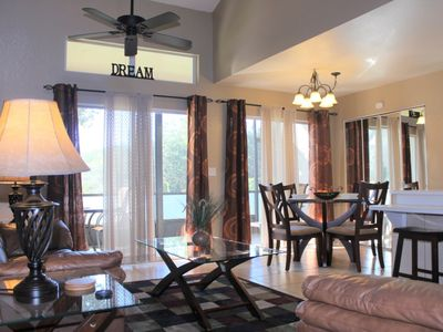Photo for Nice 3 bed 2 bath townhome with screened porch and heated community pool & spa in small gated community at Mango Key near Disney, Orlando, Florida