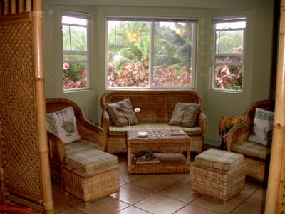 Bamboo screen separates reading area from kitchen