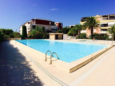 Photo for Nice bright studio with sea view terrace, swimming pool, tennis, parking, wifi
