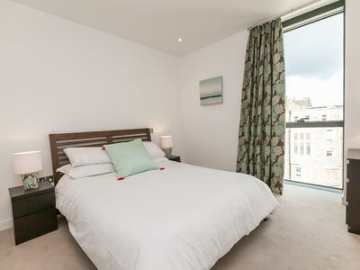 Photo for Extremely central and spacious Quartermile apartment with excellent city views!