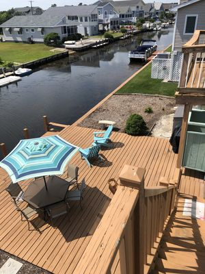 Deck, 32' Dock, Balcony from the screened porch with canal views north & south.