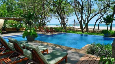 Pool and beach - View from the beach club - just a few steps from Tamarindo Beach and a short walk to town.