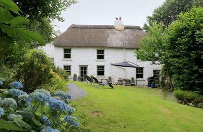Photo for This 18th century long house is situated in the characterful village of South Zeal.