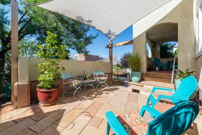 Your private patio area  is surrounded by beautiful plants 3 seasons a year.
