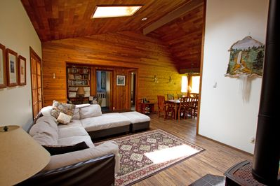 As you walk into the home, you notice cedar ceilings, oak floors, pine walls....