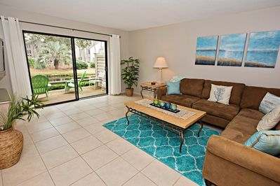 Spacious living room with a view of lagoon and golf course.