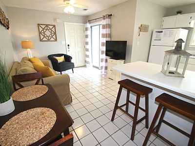 Photo for Condo Steps from Beach! 2 King Beds! Flat Screens! 2 Pools! 2 Bikes!