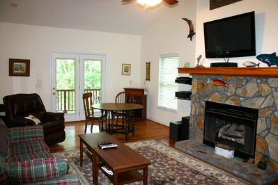 Living Room With NonWorking Decorative Fireplace, Flat Screen TV, Pull Out Couch