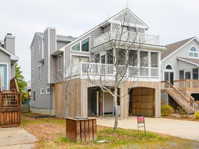 Photo for FREE DAILY ACTIVITIES!!! Located ocean side in downtown Bethany Beach just one and a half blocks from both the beach and boardwalk, this lovely 6 bedroom, 4.5 bath home