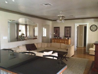 Living Room w/fireplace, large flat screen tv, bar area, entry, large comfy sofa