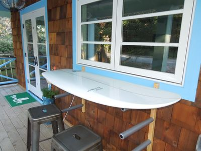 Surfboard Table w/Window that Opens to Kitchen