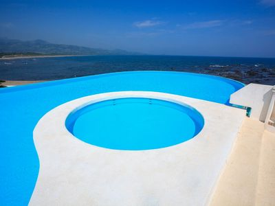 Photo for Beach club with infinity pool