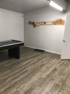 Air hockey table and coat rack in entry area