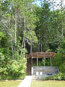 View fr. dock to the private lido,stairs & deck. Cottage is behind trees @ left.