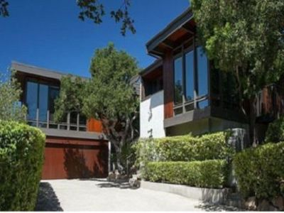 A pristine mid-century home with a private acre and beautiful views!